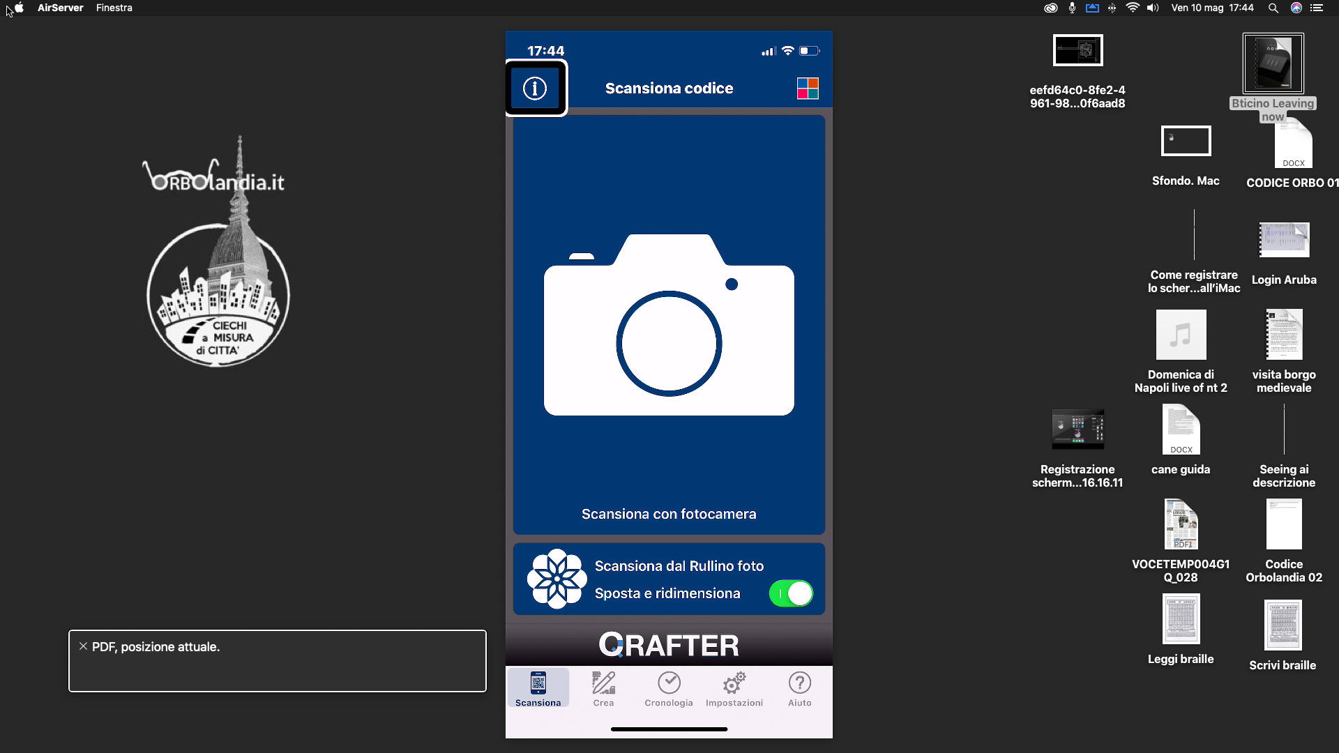 immagine dello schermo iMac con un iPhone sul quale c'è la home di QRafter